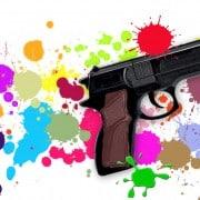 Toy gun on paint-splattered background