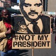 Atul Gupta protest banner