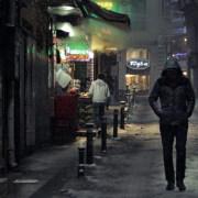 A man walking alone at night